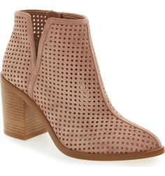 Perforated leather and a deep side notch further the understated Western influence of this wear-anywhere bootie lofted by a stacked heel.
