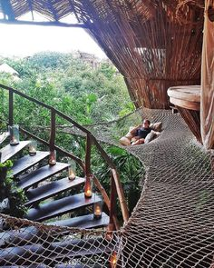 Who would you hang here with?  A bamboo cabin into the jungle of Tulum Mexico. Photo by @wanderingtrader