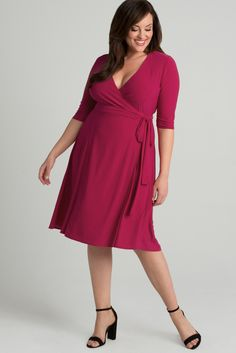 Brighten up your wardrobe with this vibrant pink! Our plus size Essential Wrap Dress is a timeless style you can wear for any occasion. A true wrap dress, you can adjust your fit for desired coverage. Available in both prints and colors. Made exclusively for women's plus sizes. Made in the USA. Shop our entire collection of plus size women's clothing at www.kiyonna.com.
