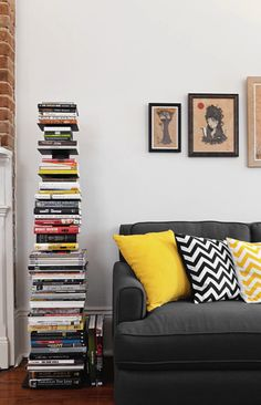 Julie Adama posted gray sofa & chevron pillows in living room to her -For the home- postboard via the Juxtapost bookmarklet. Sapien Bookcase, Vertical Bookshelf, Room Photo, Cool Bookshelves, Stoff Design, Yellow Pillows, Throw Pillows, Couch Pillows, Living Spaces