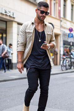Nicely designed tan shirt with nice fabric over black tank and black pants. Nice pendant helps outfit a lot.