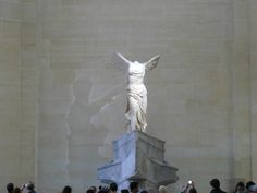 """The Winged Victory of Samothrace in the Louvre. It has been called """"the greatest masterpiece of Hellenistic sculpture."""""""