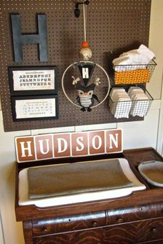 If we were having a boy: Baby Nursery Ideas / pegboard with baskets for changing table - great idea!