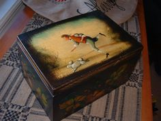 Wooden box by John Dunn.  Several compartments inside.  Added December 31, 2016.