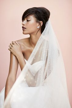 Tiny Swarovski crystals dot the length of this airy cathedral wedding veil. Find bridal accessories adorned with made-for-you details at davidsbridal.com.