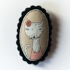 Adorbs. cat with flower - color handcrafted and illustrated brooch felt. $21.00, via Etsy.
