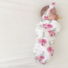 The cutest little peanut all snuggled up in our cocoon swaddle