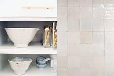 Looks like zellige tiles on right (backsplash and over hidden hood).