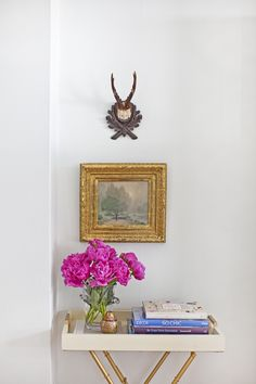 #peony, #antlers, #home-decor, #tray, #entry-table, #artwork, #floral-arrangement, #side-table, #frame  Styling & Design: Caitlin Wilson - caitlinwilsondesign.com/index2.php#/home/ Photography: Courney Apple - courtneyapple.com/  Read More: http://www.stylemepretty.com/living/2013/03/29/behind-the-blog-with-caitlin-wilson/