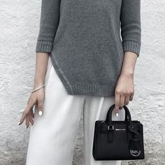 FINDERS || Gray Knit Long Sleeve Side Slit Sweater The Cheap Talk Sleeved Knit is a fitted pullover jumper with a rounded neckline, cropped long sleeves, an asymmetric curved hem shape on the right side and ribbing details on the hem, cuffs and neckband in a mid-weight knit fabric. Designed in Australia. Carried by ASOS.