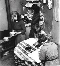c1950 France. Mealtime for a poor Parisian family.