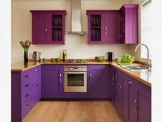 Kitchen : Impressive Kitchen Design For Apartments With Purple Wooden Floating Shelves Cabinet Mounted On The Wall And Brown Wooden Pedestal Countertop Be Equipped Chrome Stainless Sink Near Window Ideas Drop Dead Gorgeous Kitchen Decorating Ideas Brick Wall Backsplash. Grey Countertops. White Ceiling Lights.