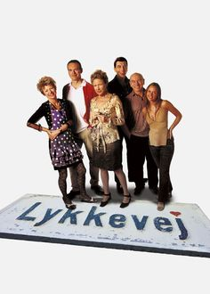 Lykkevej - When she discovers that her husband is having an affair, an upper-class wife starts life anew in an eccentric middle-class neighborhood.