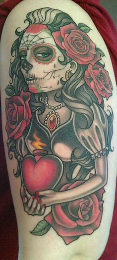 Dia de los Muertos tattoo done by artist Aaron Peters of Bugaboo Tattoo. I'm really happy with it!