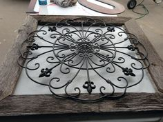 Frame wrought iron with reclaimed wood to create stunning wall art.