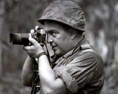 In this 1967 photo, Associated Press photographer Horst Faas works in Vietnam. Faas, a prize-winning combat photographer who carved out new standards for covering war with a camera and became one of the world's legendary photojournalists in nearly half a century with The Associated Press, died May 10, 2012. He was 79. (Photo by AP Photo)