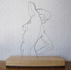 """Morning Pose"" wire sculpture by Gavin Worth"