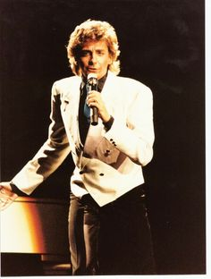 Barry Manilow on stage singing. Copacabana  Tour 1985.