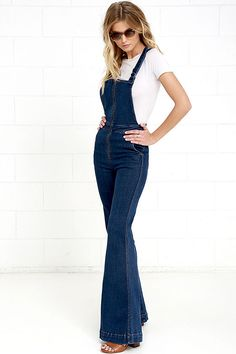 You asked for style and the Rollas Eastcoast Dark Wash High-Waisted Denim Flare Overalls are here to deliver! Medium-weight, stretch denim overalls have a silver zipper-accented bodice supported by adjustable straps that crisscross at back. High, banded waist transitions into flaring pant legs with diagonal front pockets and back patch pockets with logo tag. As Seen On Jill of @littleblackboots and Tenley of @tenleymolzahn!