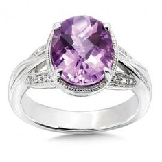Sterling silver amethyst and diamond ring  $495