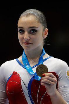 Gymnastics Aliya Mustafina | ... photo aliya mustafina aliya mustafina of russia poses after winning