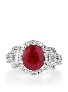 Cushion ruby set in diamond pave frame flanked by kite shape diamonds.  By Bez Ambar.  Available at Alson Jewelers.