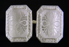 A beautifully engraved pair of Edwardian cufflinks with stylized floral designs and classic egg-and-dart borders.  These elegant cufflinks were created by Charles Keller & Co. in the early 1900s.  The firm specialized in intricately engraved cufflinks with platinum tops.  Crafted in 14kt gold and platinum, circa 1910.