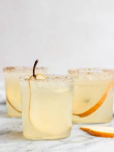 An easy Pear Vanilla Gin Fizz Cocktail with homemade pear syrup, vanilla syrup, and gin! This pear cocktail makes the perfect Fall cocktail for a crowd. This simple gin cocktail recipe is a twist on a classic gin fizz with no eggs and a vanilla sugar rim. A delicious pear vanilla drink that is fun and makes the perfect pretty signature cocktail for a wedding or party. #pearcocktail #vanillacocktail #cocktail #recipe #sgtoeats