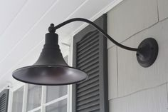 Exterior Colors: House: SW Amazing Gray, Trim: Martha Stewart Glass of Milk, Door & Shutters: SW Urbane Bronze