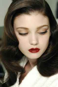 soft vintage look with plush nude eyeshadow and ruby red lips