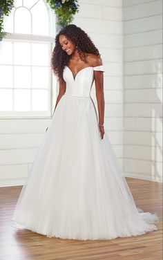 This modern take on the romantic ballgown is your next stop to bridal bliss. A clean yet soft silhouette, the matte Mikado bodice has a slightly plunging sweetheart neckline and off-shoulder straps, reinforced with elasticity for comfort and ease of movement. Visible seaming contours the body for a beautiful shape, while multiple layers of tulle throughout the full skirt and train are finished with horsehair and organza for a light finish. V Neck Wedding Dress, Classic Wedding Dress, Bohemian Wedding Dresses, Wedding Dress Trends, Essense Of Australia Wedding Dresses, Designer Wedding Gowns, Bridal Collection, Bridal Gowns, Ball Gowns