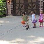 Roll the ball relay in preschool