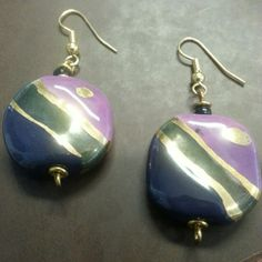 Kazuri Earrings Exclusive handmade earrings from Kenya. These quarter-sized, clay-based earrings were made at the popular Kazuri bead shop. Hand-painted, the design is one of a kind. Kazuri Jewelry Earrings