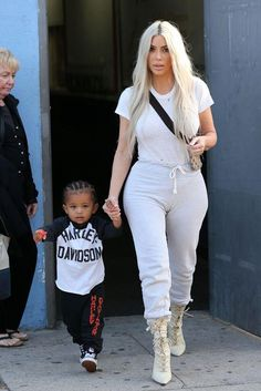 Kim Kardashian wearing James Perse Sheer Slub Crew Shirt, Billy Johnny Sweatpants, Gucci Canvas Belt Bag and Yeezy Lace Up Boots