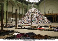 Christian Boltanski 'No Man's Land (2010), an enormous pile of discarded jackets set to the soundtrack of thousands of human heartbeats, suggesting the anonymity, randomness, and inevitability of death'