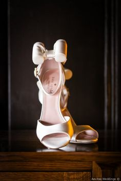 Adorable wedding day shoes - white heels with bow on heel {Aevitas Weddings}