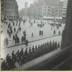 1944 - 1945. SS-troops marching at the Dam in Amsterdam. Photo MAI Beeldbank / Ad Wendig. #amsterdam #worldwar2 #Dam