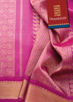 A vision in lotus pink and gold, dedicates itself to making heads turn. The mango and deer motifs on the pallu is matched evenly in gorgeousness by the graceful bird and wheel patterns on the body. #Utppalakshi #Sareeoftheday#Silksaree#Kancheevaramsilksaree#Kanchipuramsilks #Ethinc#Indian #traditional #dress#wedding #silk #saree#craftsmanship #weaving#Chennai #boutique #vibrant#exquisit #pure #weddingsaree#sareedesign #colorful #elite