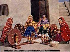 Cheerful punjabi women busy at the Charkha (spinning wheel )