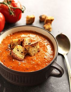 Healing Roasted Tomato and Red Pepper Soup - Creamy soup bursting with roasted tomatoes, red peppers, onion, and garlic. This recipe is EASY to make! We LOVE this recipe in the fall/winter!! vegan/gluten free | robustrecipes.com