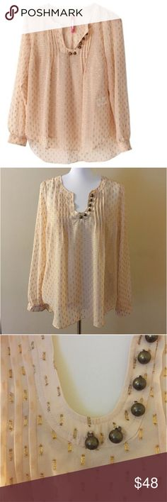 """Anthropologie Tracy Reese Plenty Peasant Blouse M Anthropologie Tracy Reese Plenty Spun Meteoroid Peasant Blouse --- blush colored with gold metallic embellishment --- very good preloved condition --- blouse has an attached blush camisole ---brass tone buttons detail the neckline --- puffed sleeves with fitted cuffs --- the shell is 97% polyester and 3% metallic --- camisole is 100% polyester --- camisole bust and length 18""""/24"""" --- camisole straps are adjustable --- bust of shell is 21.5""""…"""