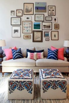 gallery wall and frame positioning, lamps on both sides of sofa, pillow symmetry