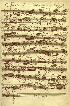 "1720: Handwritten ""First Sonata for Solo Violin: Adagio"" sheet music by German composer Johann Sebastian Bach."