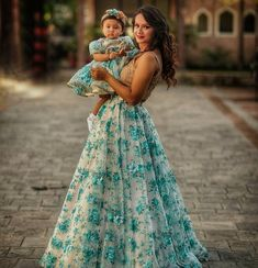 Image may contain: 2 people, people standing and outdoor Mom Daughter Matching Outfits, Mommy Daughter Dresses, Mom And Baby Dresses, Mom And Baby Outfits, Mother Daughter Fashion, Baby Girl Dress Patterns, Dresses Kids Girl, Kids Party Wear Dresses, Birthday Dresses