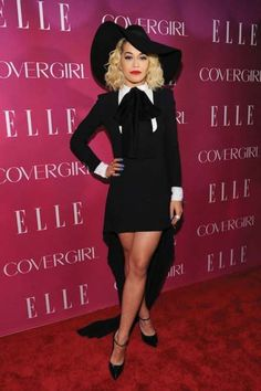 Rita Ora in a black high-low dress and black ankle strap heels