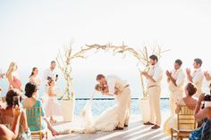 get married under a driftwood arch   photo: sara & rocky   via emmalinebride.com