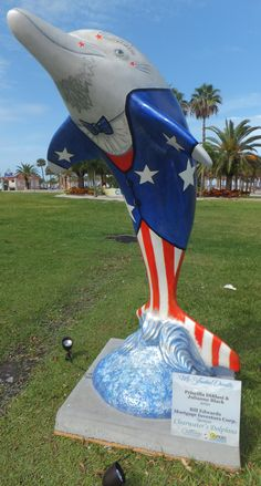 Dolphin artists: Priscilla DiBlasi and Julianne Black designed this for Bill Edwards, Mortgage Investors Group.  It is one of 50 decorated dolphins at Pier 60 Park in #Clearwater until 9/4/12.