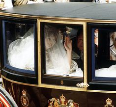 According to David Emanuel, Diana kept asking for a larger and larger train. While the team practiced folding the excess fabric, the bulk of taffeta eventually got crushed in the glass coach she took to St. Paul's Cathedral. The cramped ride caused the visible wrinkles upon her arrival, Elizabeth Emanuel told the Daily Mail.