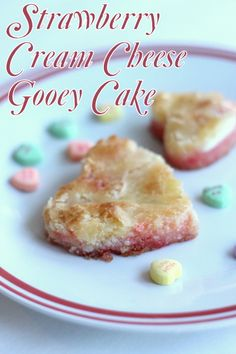 Strawberry Cream Cheese Gooey Cake -- perfect for serving heart shaped portions for Valentine's Day.