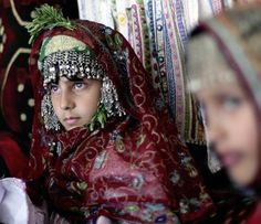 Yemeni girls wear traditional outfits during a birth ceremony known as 'Welad', in Sanaa | ©Hani Mohammed / AP Photo